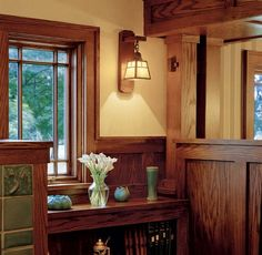 """Bookend"" returns on the screen wall between the living and dining rooms support double clustered and cross-tied columns."