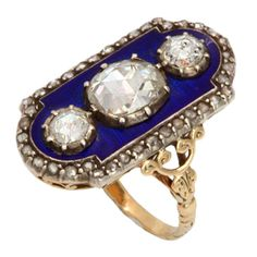 Georgian Three Diamond Ring of Striking Beauty  England  c.1790  Dark royal blue enamel is the background for three bright antique rose cut diamonds of approximately two carats in weight.