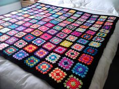 This 5ft blanket was made with basic granny squares. I used the continuous join method for joiing the squares and then added 2 rows of granny stitch,1sc (dc) row a final half dc(tr) row I used a 4.5mm hook Woolcraft New fashion dk.