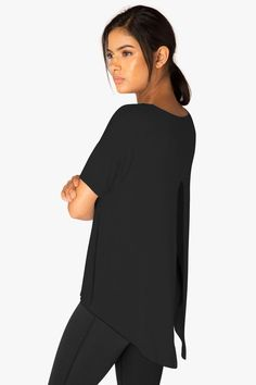 Classic V neck with a split cut out back allowing yourself to add your own spunk. Dropped shoulders and short sleeves high-low hem and loose fit.  Roll Slice Tee  by Beyond Yoga. Clothing - Tops Iowa