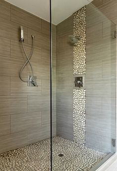 In vertical areas, maximize the textured effect of cobblestones with a stacked mosaic instead of a flat one, like the Cobblestone Beige 3D Stacked Marble Mosaic Tile.  This type of tile would be uncomfortable on the floor, but adds visual interest stacked up the wall of a shower.