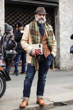 Shop this look on Lookastic:  https://lookastic.com/men/looks/blazer-waistcoat-long-sleeve-shirt-jeans-brogues-hat-tie-scarf/13095  — Dark Brown Wool Hat  — Blue Chambray Long Sleeve Shirt  — Navy Vertical Striped Tie  — Brown Waistcoat  — Beige Wool Blazer  — Olive Plaid Wool Scarf  — Navy Jeans  — Brown Leather Brogues