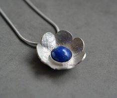 Sterling silver flower necklace with lapis lazuli. by Kailajewellery on Etsy Mens Sterling Silver Necklace, Sterling Silver Flowers, Silver Pendant Necklace, Handmade Sterling Silver, Sterling Silver Chains, Sterling Silver Pendants, Heart Jewelry, Metal Jewelry, Gemstone Jewelry