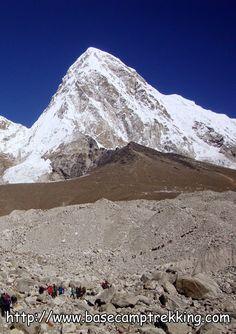 Mount #Pumori 23,494 feet (7,161 m), Kala Patthar 8,514 feet (5,643 m) a notable landmark below the peak (best view point of highest peak) and Khumbu Glacier Travelers crossing Khumbu glacier, it is the way to world famous Everest base camp trekking in Nepal