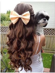 Curled with Braids and a Bow... Simple, yet Pretty. Definitely trying this.