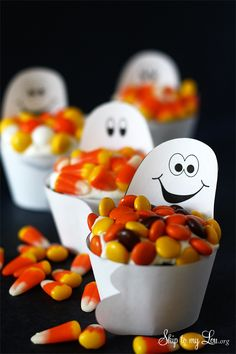 Free printable candy loving ghost cupcake wrappers for Halloween! Dress up store bought treats or homemade for a party treat or favor. #print #halloween www.skiptomylou.org