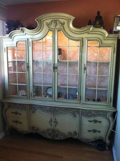 i would like to find an antique french provincial china cabinet