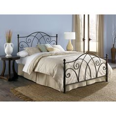 Black Wrought Iron Bed Frame - gives the room an elegant look. Easy to hang bags lying around on the ends of the bed