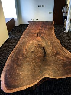 Delivered this 16' single slab live edge conference table. Made of highly figured California Claro Walnut, it rests on our blackened steel Shear Base. - Taylor Donsker Design