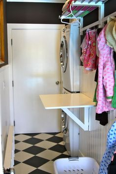 Love this little folding table for the laundry room. Ours is so small I don't think it would fit.
