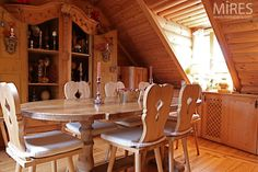 love the table, chairs, and hutch!  A Chalet Under the Roofs of Paris