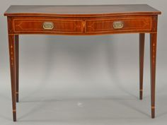 Margolis mahogany server with serpentine top over one long drawer on square tapered legs with line and bell flower inlays, signed with paper labels (top darkened in need of finish/cleaning).  ht. 32in.; wd. 43 1/2in.; [...more]  Estimate: $250 - $450