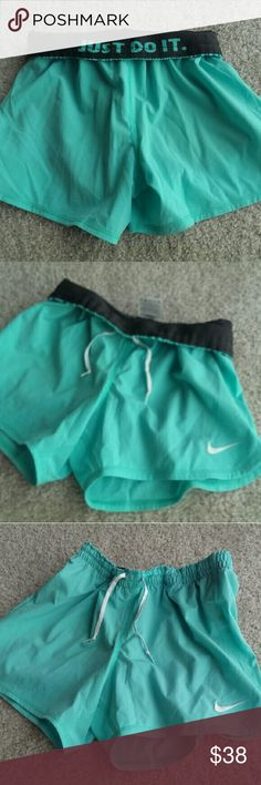 NIKE FOLD DOWN JUST DO IT SHORTS XS Price firm Never worn.  In my storage of clothes bags.  You cannot get these anymore. I kept these in storage due to moving a few times.  NEW CONDITION NEVER WORN.  THE COLOR IS MORE OF A MINTY PISTACHIO GREEN. Nike Shorts