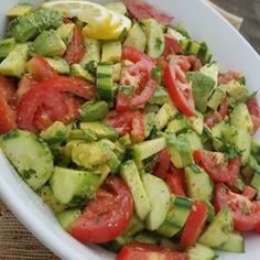 Summer Tomato Avocado Salad w/ our favorite homemade Greek dressing. | Clean Food Crush