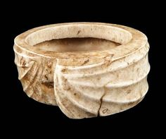 Bracelet worn by Iban men from Sarawak state | Carved from a giant clam shell ~  Tridacna gigas