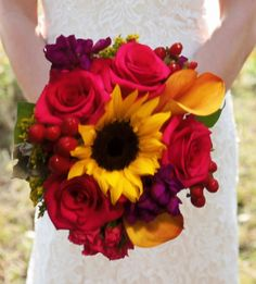 calla lilies, sunflowers and rose bridal bouquet hot pink, purples and yellow wedding  arranged by Enchanted Florist in Taos New Mexico.  Country Side Bound by Enchanted Florist http://www.taosflorist.com/weddings/taos-wedding-flowers/