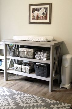 DIY changing table in a white-and-gray nursery with tribal, Aztec rug and horse painting