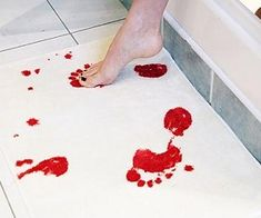 Blood Bath Mat. It would be fun in the boys bathroom with the shark stuff that's there already.