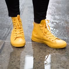 On this dreary rainy day, we're stepping into puddles, wet-free, with a pair of cheery yellow rubber chucks, brought to you by Converse's new All Star high-tops redesigned to stand up to mild sprinkles or torrential downpours. Rainy day footwear has never been so slick! Photo credit: Sarah Balch for InStyle.com