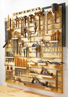 Look at this perfect tool rack organization. It was made from new wood in the link where we found it, but could easily be made out of pallets or with Rust-Oleum wood stain!: