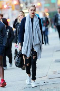 Gigi Hadid in Joe's Finn Skinny Ankle jeans, a navy sweater, and White + Warren cashmere wrap.
