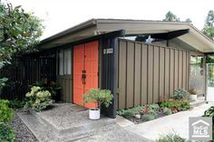 love the dark exterior with a bright front door!