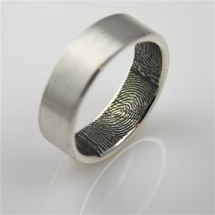 a custom and unique wedding band idea. Your finger prints create the design