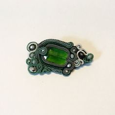 Brooch with silk and glass beads faceted. by DanuttaHandGallery