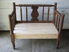 She made this bench out of an old crib.  Seriously cool.  These kind of old cribs are easy to find at garage sales/Goodwill.