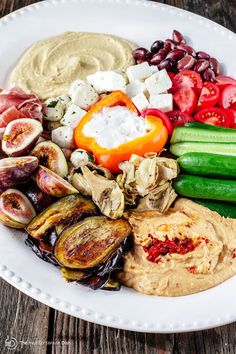 Mezze: How to Build the Perfect Mediterranean Party Platter | The Mediterranean Dish . Ditch boring party platters and try this no-cook, impressive Mediterranean mezze platter. With Sabra hummus, yogurt dip, veggies, olives, cheeses, and more! Pin it for your next party!