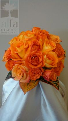 Love the foliage accenting this all orange rose bouquet!