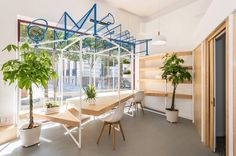 the scheme has been conceived as a simple storefront complete with an eye-catching sign that spells out 'turismo alcázar' in…