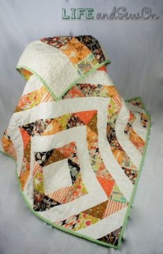 Handmade Lap Quilt. Fabrics are premium quilting cottons. The front is Kona solids white, and Bonnie Christines CULTIVATE line. The back of the