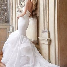 This trumpet bridal gown with a cascading skirt by @alvinavalenta will have you walking down the aisle in perfection.