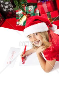 close-up of a smiling girl writing letter to santa. - Close-up portrait of a smiling girl writing letter to santa, Model: Shania Chapman - Agent is Breann at MMG.