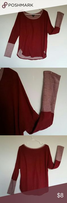 Sweater This is a red maroon puller over sweater with a high low waist. Sleeves are half maroon red and a light white shade of red, i wear a medium and this is a large, it does fit loosely so it could fit maybe an extra large. This sweater is meant to hit not mid thigh but alittle higher, covers your no no area and buttocks. The red color is not that bright, its red but has a hint of maroon color...hard to explain Rue 21 Sweaters Crew & Scoop Necks