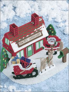 "Santa's Workshop - Children of all ages will delight in this festive centerpiece. This e-pattern was originally published in Christmas Traditions in Plastic Canvas.   Size: 13 1/4"" x 8 1/4"" x 10 1/4"" (33.7cm x 21cm x 26cm). Made with medium (worsted) weight yarn, metallic craft cord and 7-count plastic canvas.   ITEM #EP00187	PRICE $2.99"