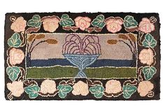 Pictorial American hooked rug with a compote surrounded by cattails with a stylized floral border.