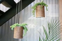 So fun and simple!  DIY hanging twine flower pot cans===>