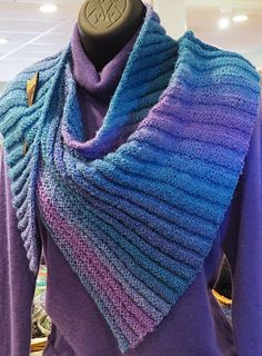 The finished asymmetric shawlette measures about 4 feet by 16 inches with an icord edge knit as you go. This shawlette works well with a yarn having a long color lead. The shawlette has been minimally blocked to help keep the elasticity of the ribs.