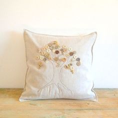 Linen Pillowslip cushion cover with Vintage by ShopArcheologie, €32.00. Could easily make yourself with a plain pillow cover and trace the outline of the tree trunk then sew over with a dark brown thread. the hand sew the buttons on