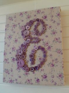 fabric-covered canvas with button letter- beautiful