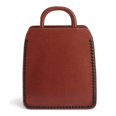 Monica-Forster-Stitches-and-Buttons-leather-bags-for-Palmgrens_dezeen_6.jpg