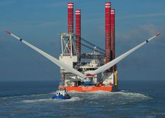 "Offshore Jack-Up Vessel, Bold Tern, carrying Alstom's Haliade 150 at Belwind Offshore Wind Farm with the two turbine blades (manufactured in Denmark by LM Wind Power) in the ""Bunny Ears"" position. (Courtesy Alstom)."