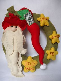 Guirlanda de Natal - Papai Noel <br> <br>Guirlanda em feltro <br>Mede: 34cm