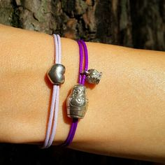 Cord bracelet with sterling silver heart charm and Cord bracelet with sterling silver matroyshka and russian crown charm.