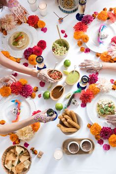 No shortage of flowers with this festive table decor. Great for a casual Cinco de Mayo get-together!