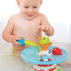 Musical battery operated bath toy with unique water circulation pumping system introducing a water bath duck race and fountain by Yookidoo®