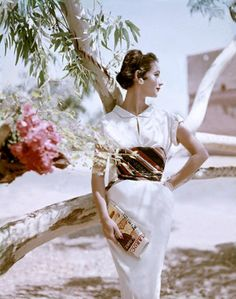Model is wearing a dress of cotton challis with wrapped fabric around her waist, by Samuel Winston