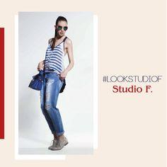 Una T-shirt de rayas horizontales azul y blanco hace contraste ideal con tus boyfriend jeans. Look StudioF perfecto para tu fin de semana. StudioF Costa Rica